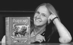 cornelia funke poses with her book inkheart 2004 landov llc all rights reserved - Cornelia Funke Lebenslauf