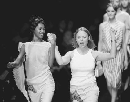 Stella McCartney (center) acknowledges applause after a Paris fashion show in 2000. AP/Wide World Photos. Reproduced by permission.